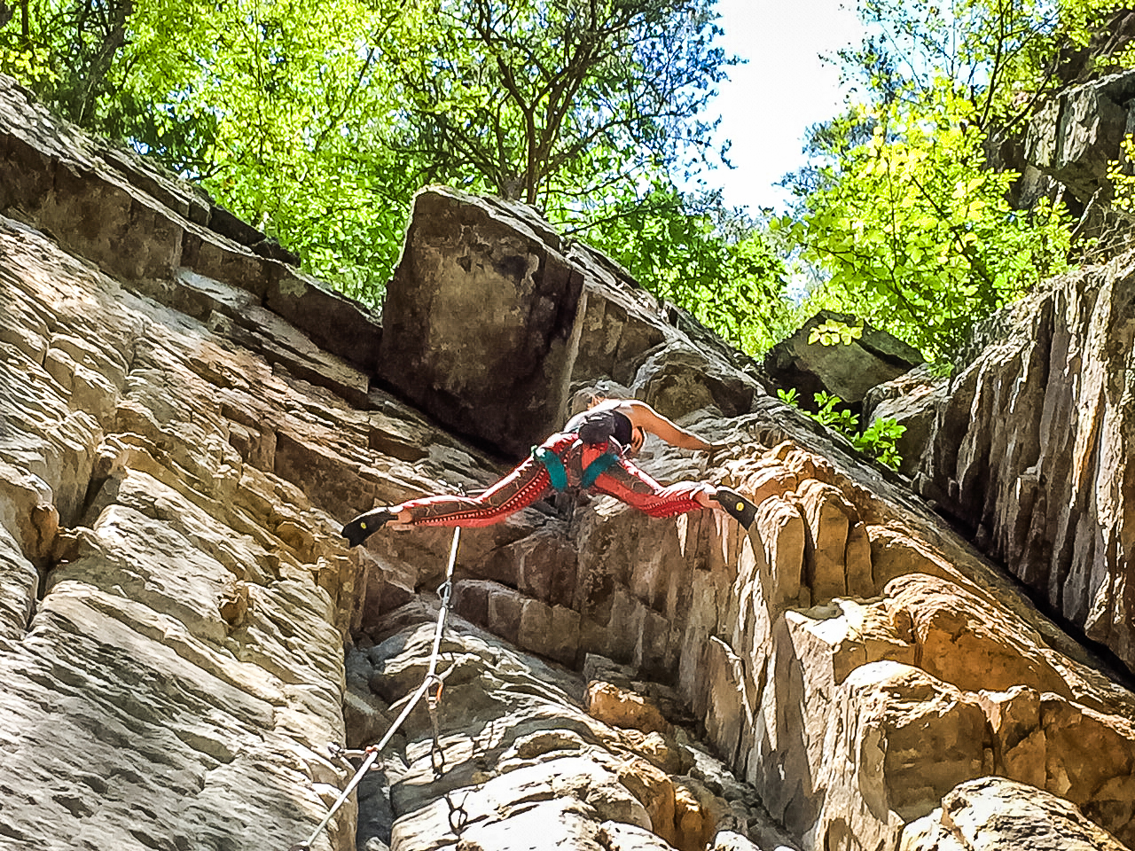 Raisa climbing Aloha (5.9) in Franklin Gorge, West Virginia
