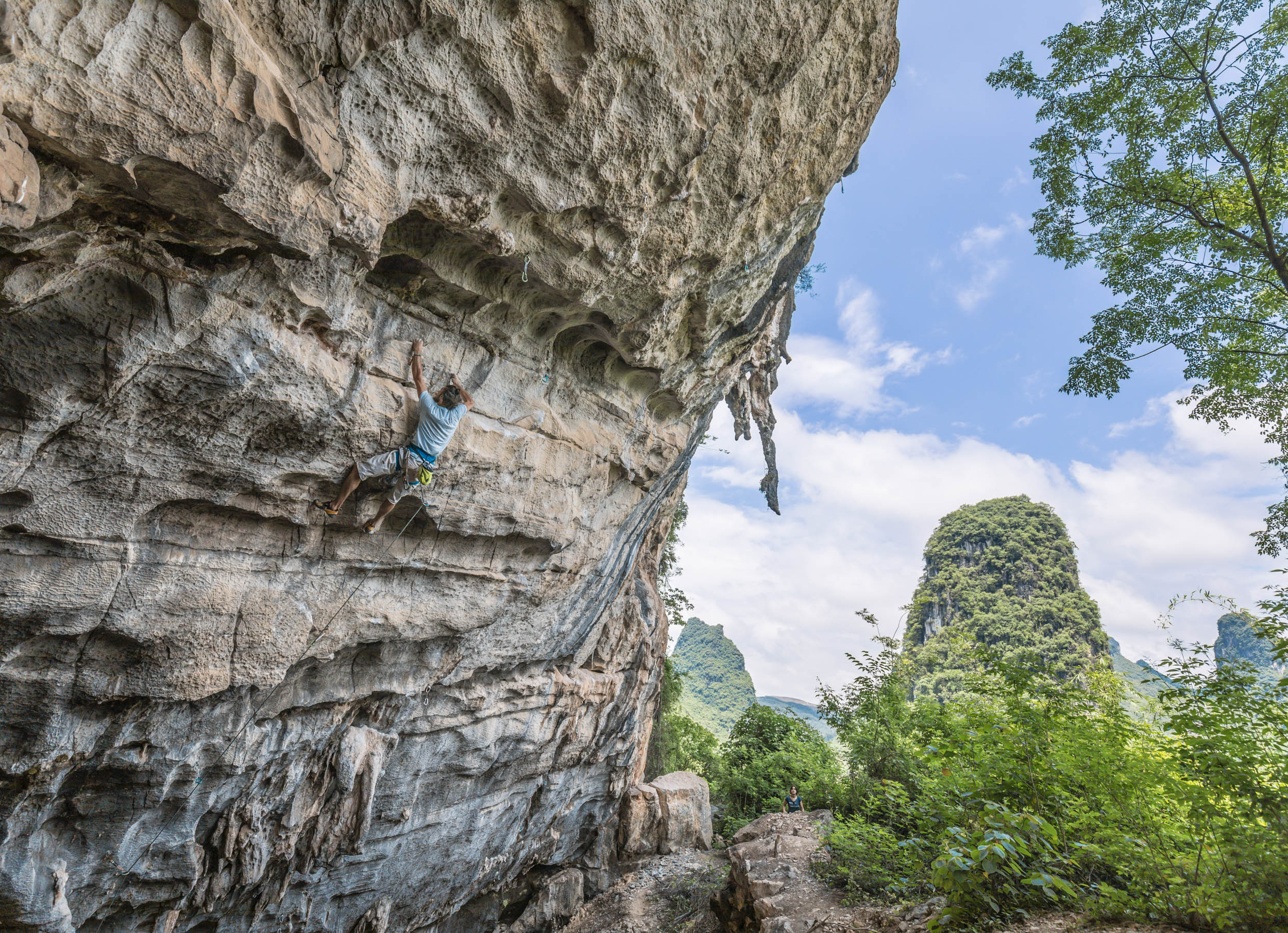 Miguel climbing his project, 5.14d, in Area 515, Yangshuo