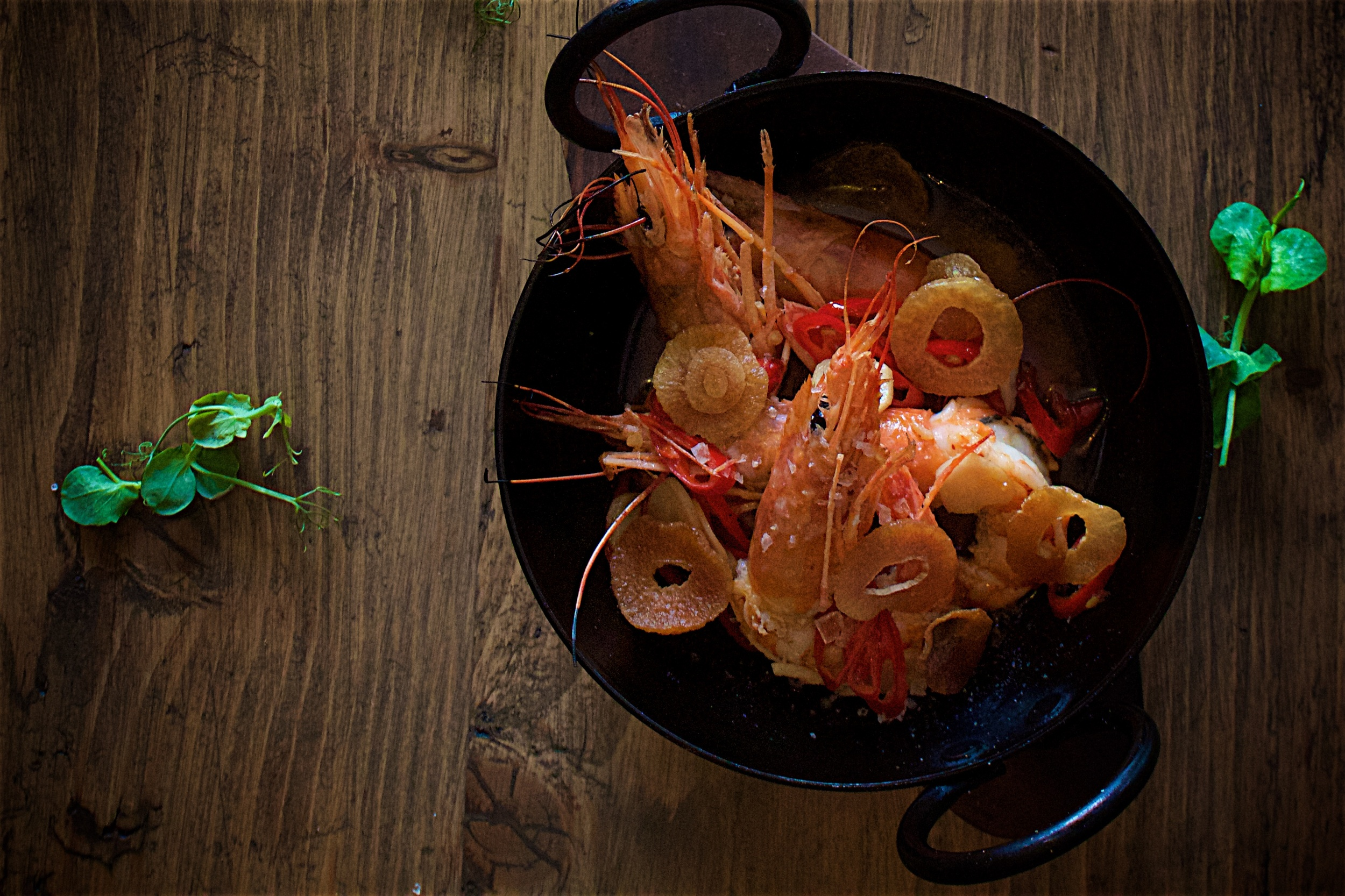 GAMBAS AL AJILLO - Pan cooked prawns with garlic and red chillies in olive oil.