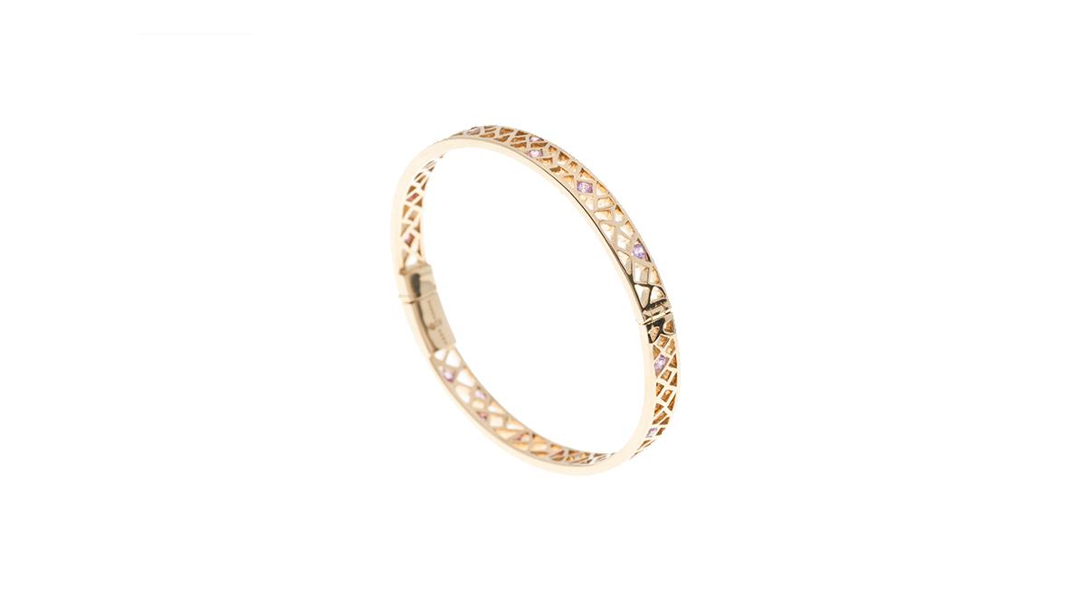 Bracelet, pink sapphires 18 carats yellow gold.