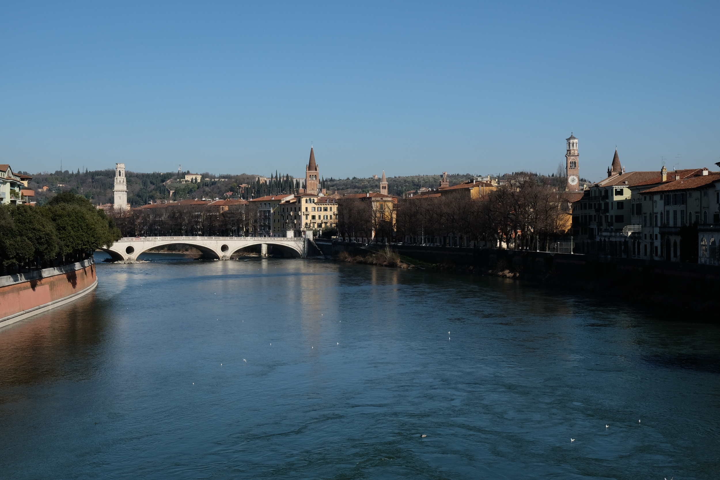 Adige River runs a perimeter around the center of Verona. Also, SO many church towers. Six just in this photo!