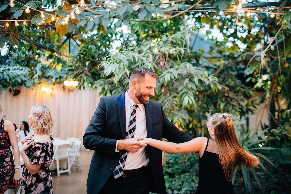 Jason dancing with his daughter.