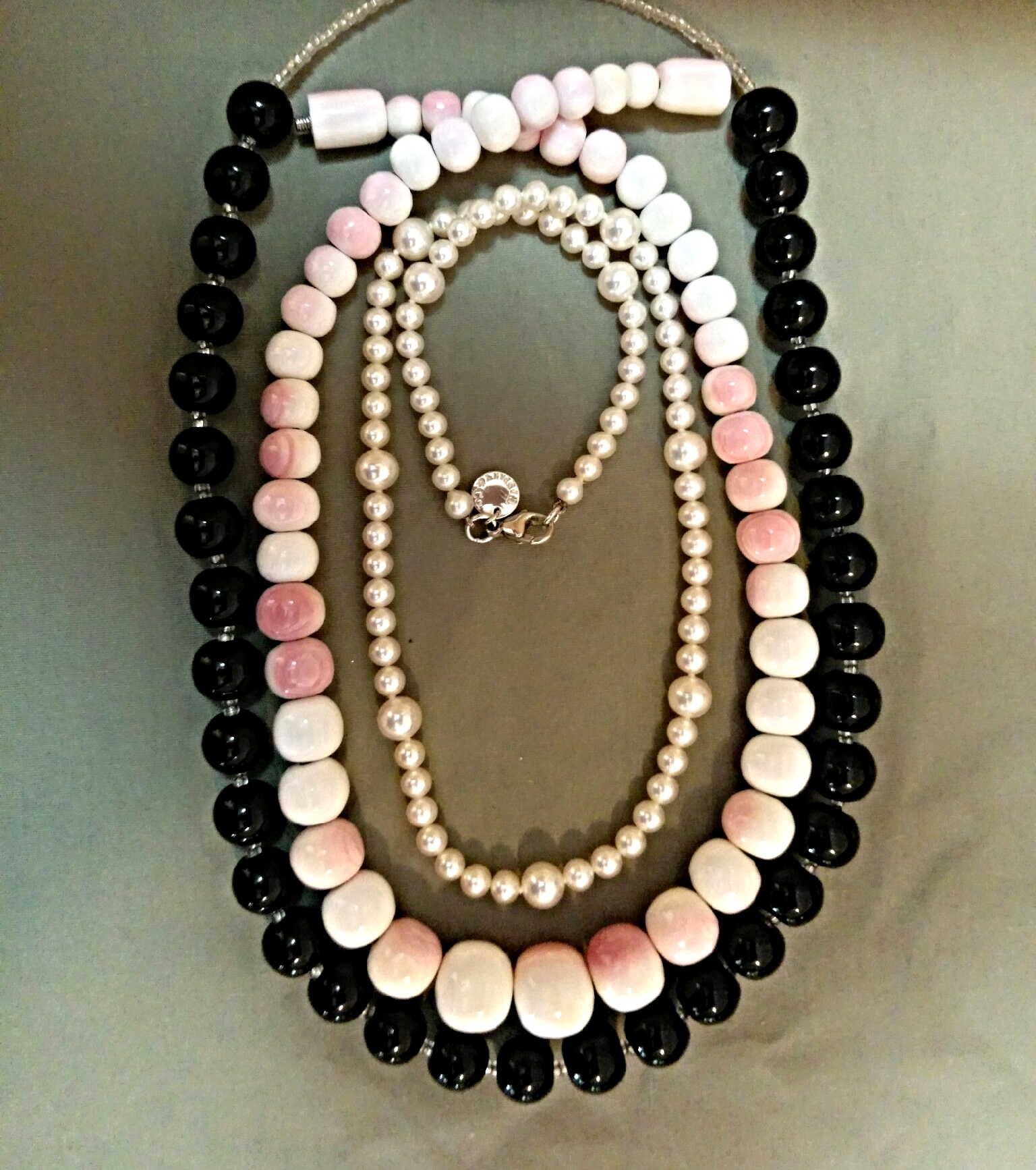 Onyx, conch shell, and pearl Strands