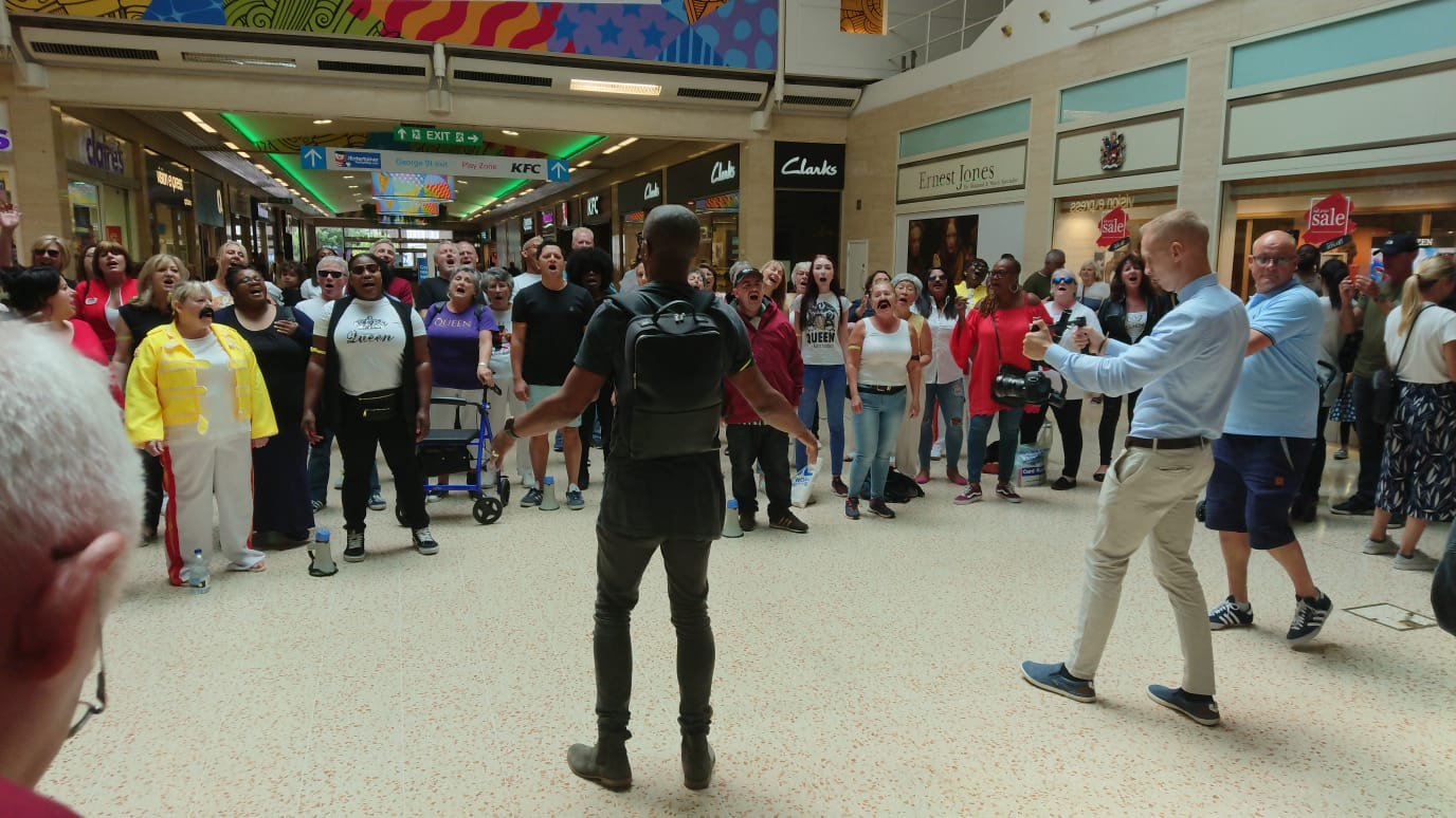 Mark conducting the Choir at the Performance in the Mall, Luton