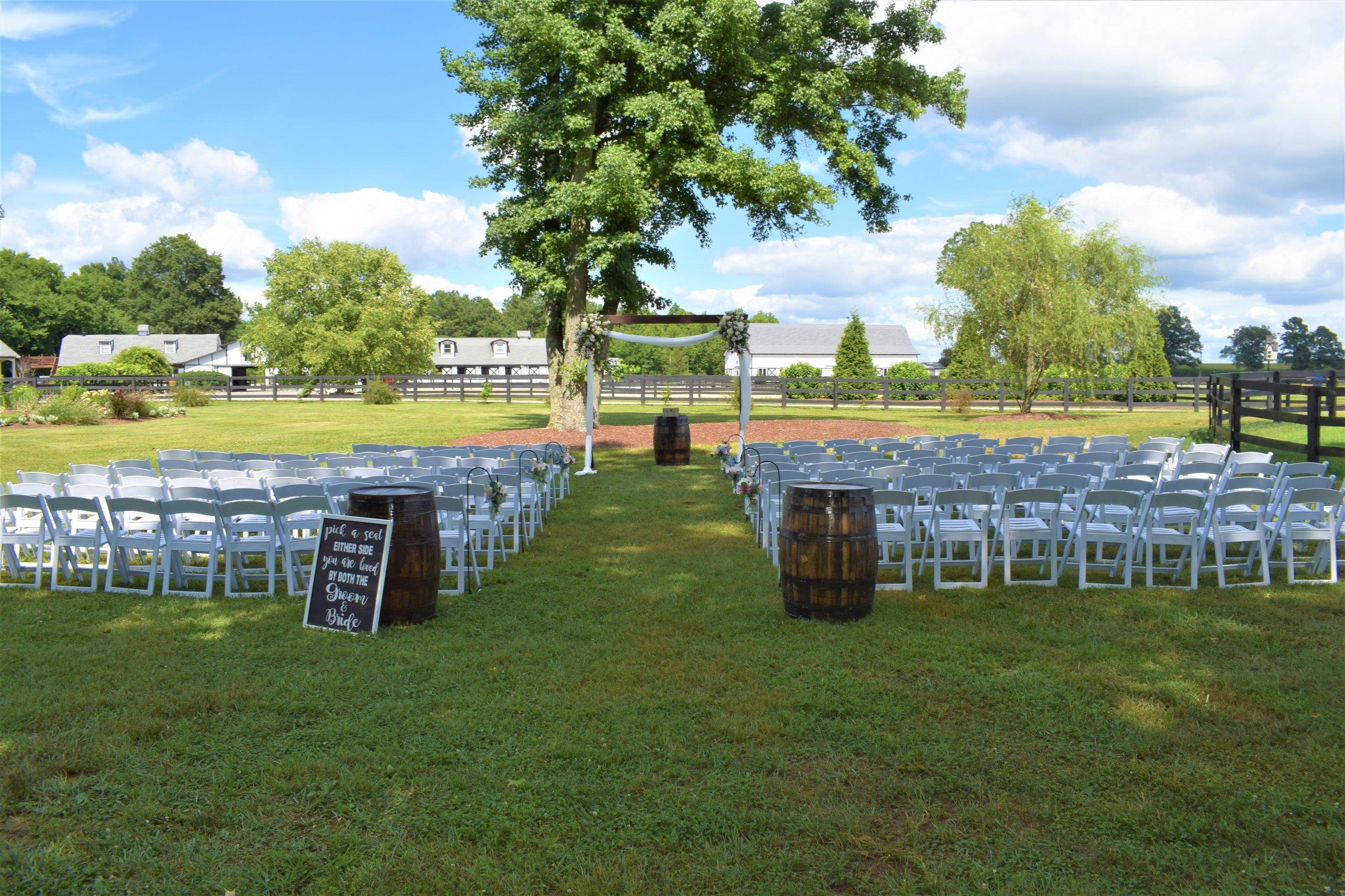 July field ceremony facing barn