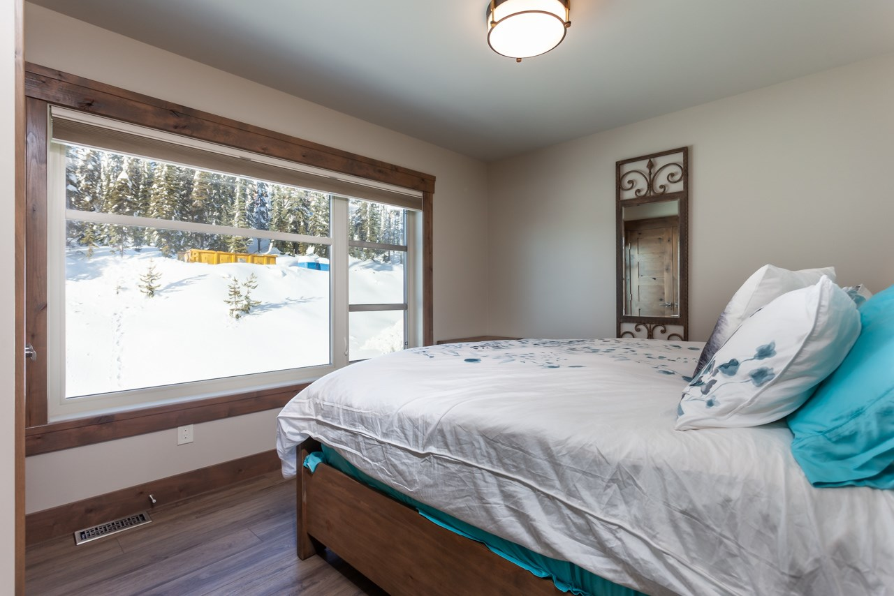 530-feathertop-way-big-white-bc-canada-bedroom-slope-side.jpg