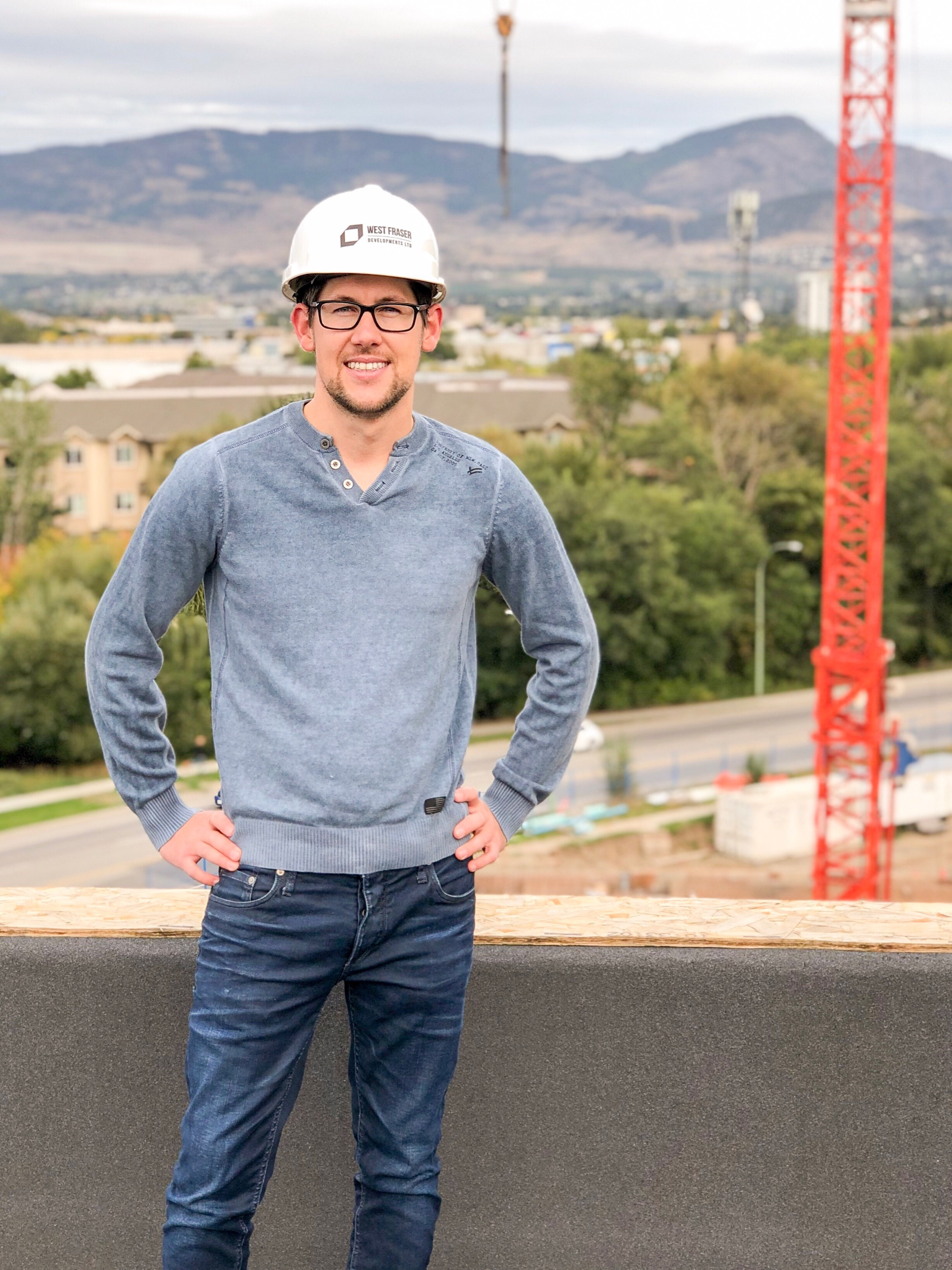 Joshua Elliott, Kelowna REALTOR, a top the nearly complete Hyatt Place Hotel overlooking the development site of the upcoming Beverly condominium project in Kelowna's midtown neighbourhood.