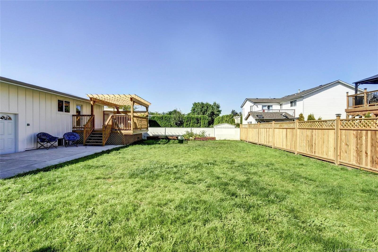 505-hollywood-road-south-farmhouse-inspired-family-home-kelowna-rutland-exterior-backyard.jpg