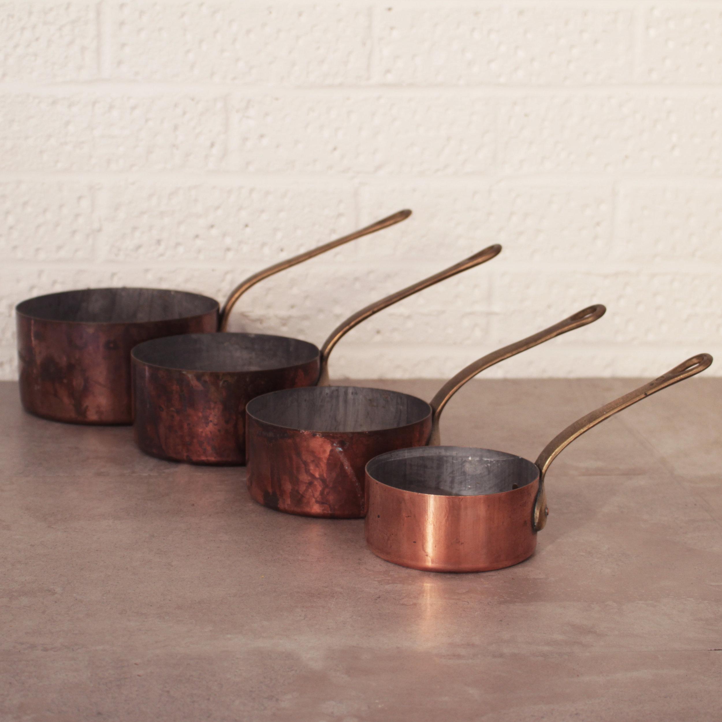 SET OF FOUR COPPER PANS £10