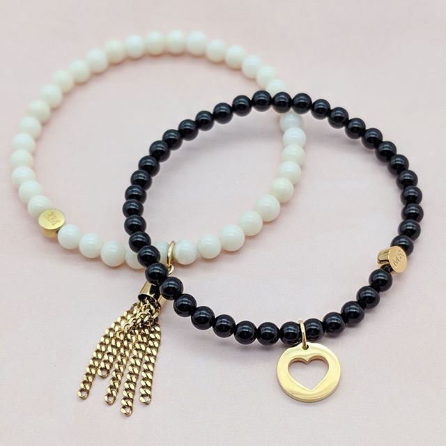 Black or White? Onyx or Coral? No need to pick just one when they look so Good together! #forgood #beadbracelets #bettertogether #jewelryforgood #jewelrywithmeaning #onyxbracelet #coralbracelet