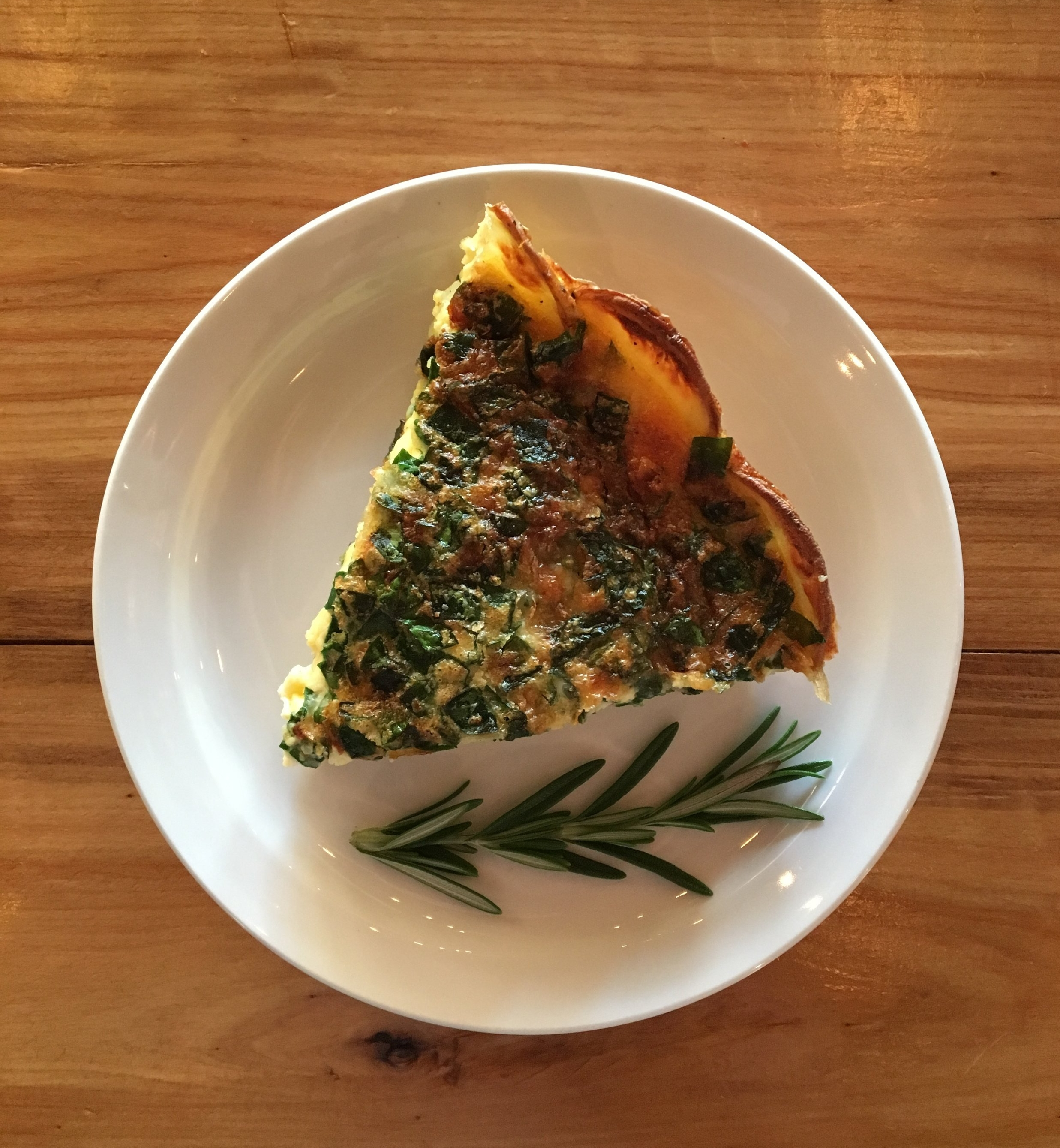 Quiche (GF)  Made with a potato crust, spinach and gruyere cheese. Other ingredients change seasonally.