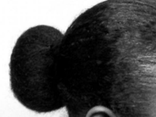 Akua Agyemfra said she was wearing her hair in a bun like this when her manager sent her home.