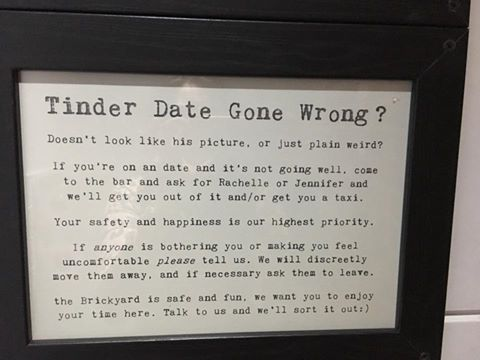 A bar in England has a sign offering to help women on bad Tinder dates