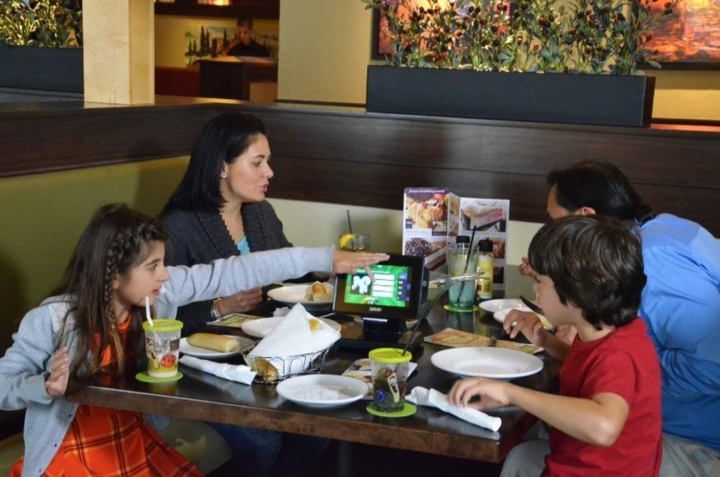 Restaurant tabletop tablet games are a great way for family guests to pass the time while waiting for dinner to arrive.