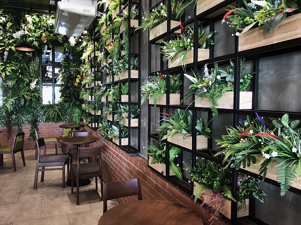 Add plants to your restaurant's interior design to boost it's Instagram-ness