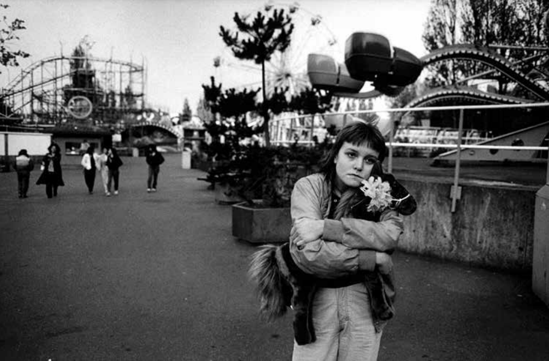 Erin holding her Horsey, a gift from Mary Ellen Mark, at a theme park in the early 1980s. Photograph by Mary Ellen Mark.