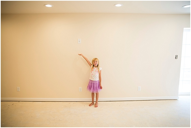 Maddie proudly displaying where the Tv will go for the viewing area!!