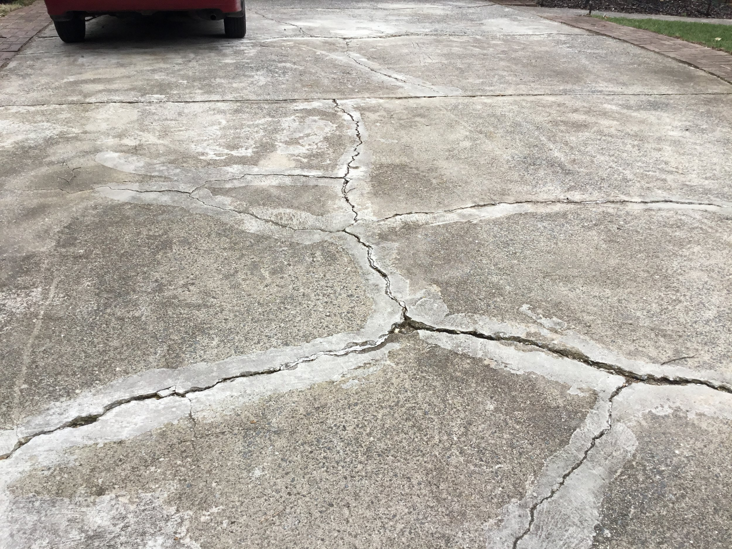 See how bad the cracks are? Matthews, NC driveway before picture