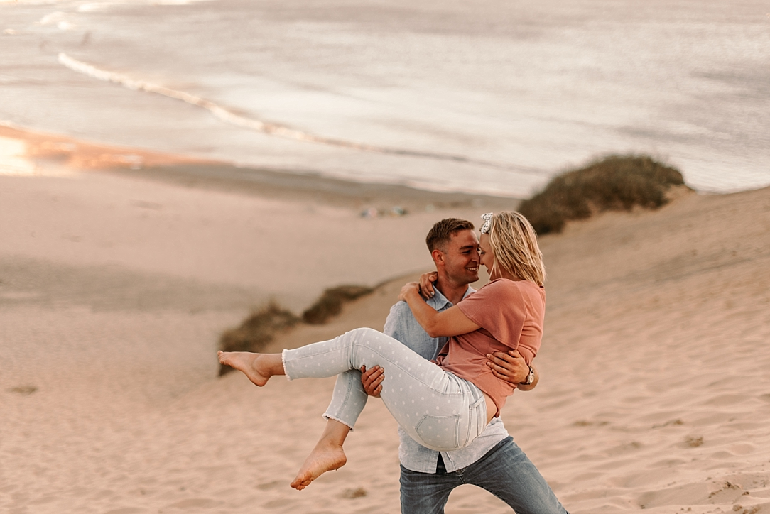 playful summer couple beach session_0030.jpg