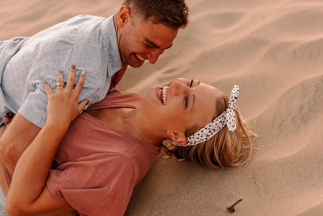 playful summer couple beach session_0036.jpg