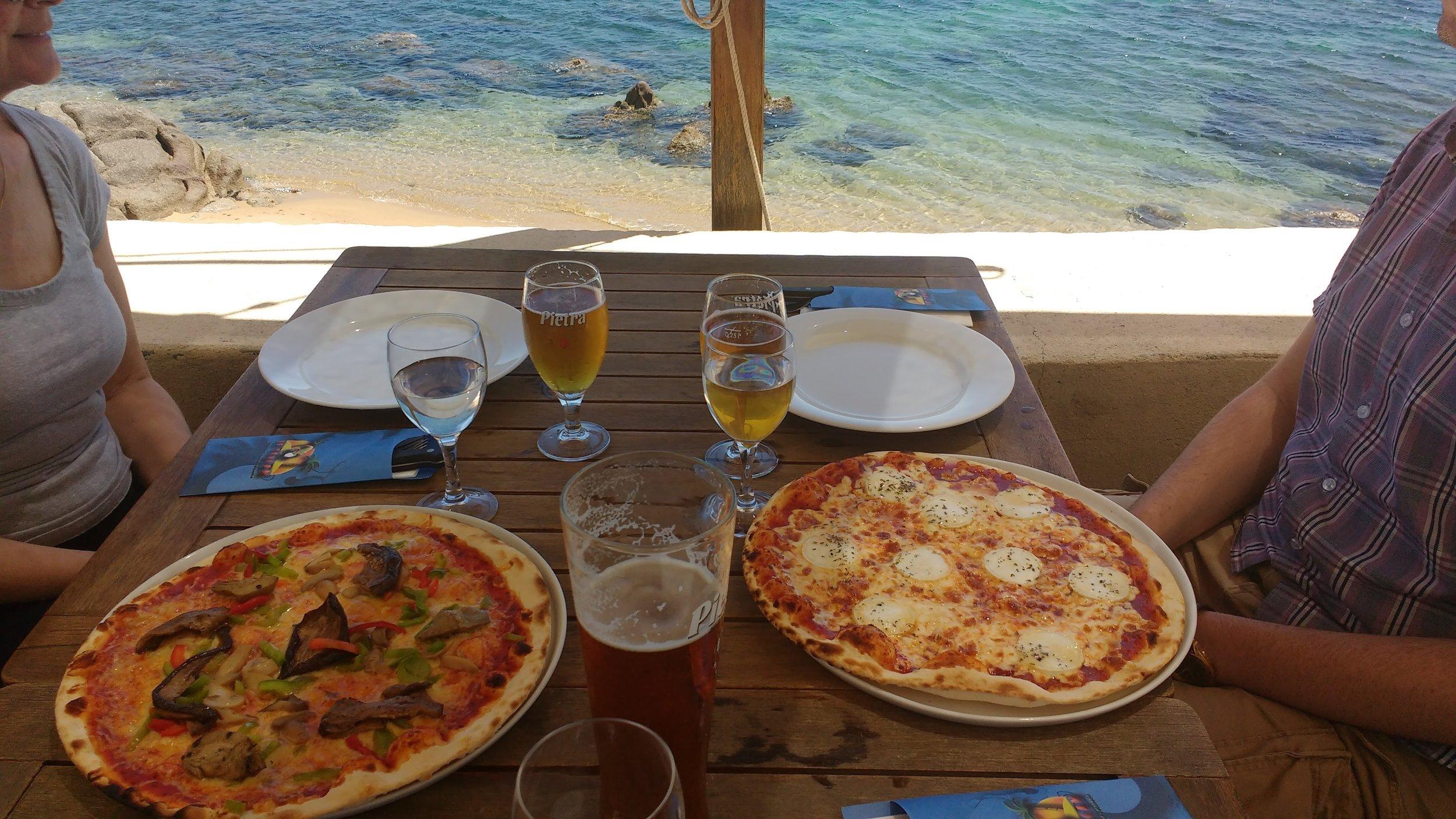 Italian thin crust pizza overlooking the Mediterranean in Corsica!