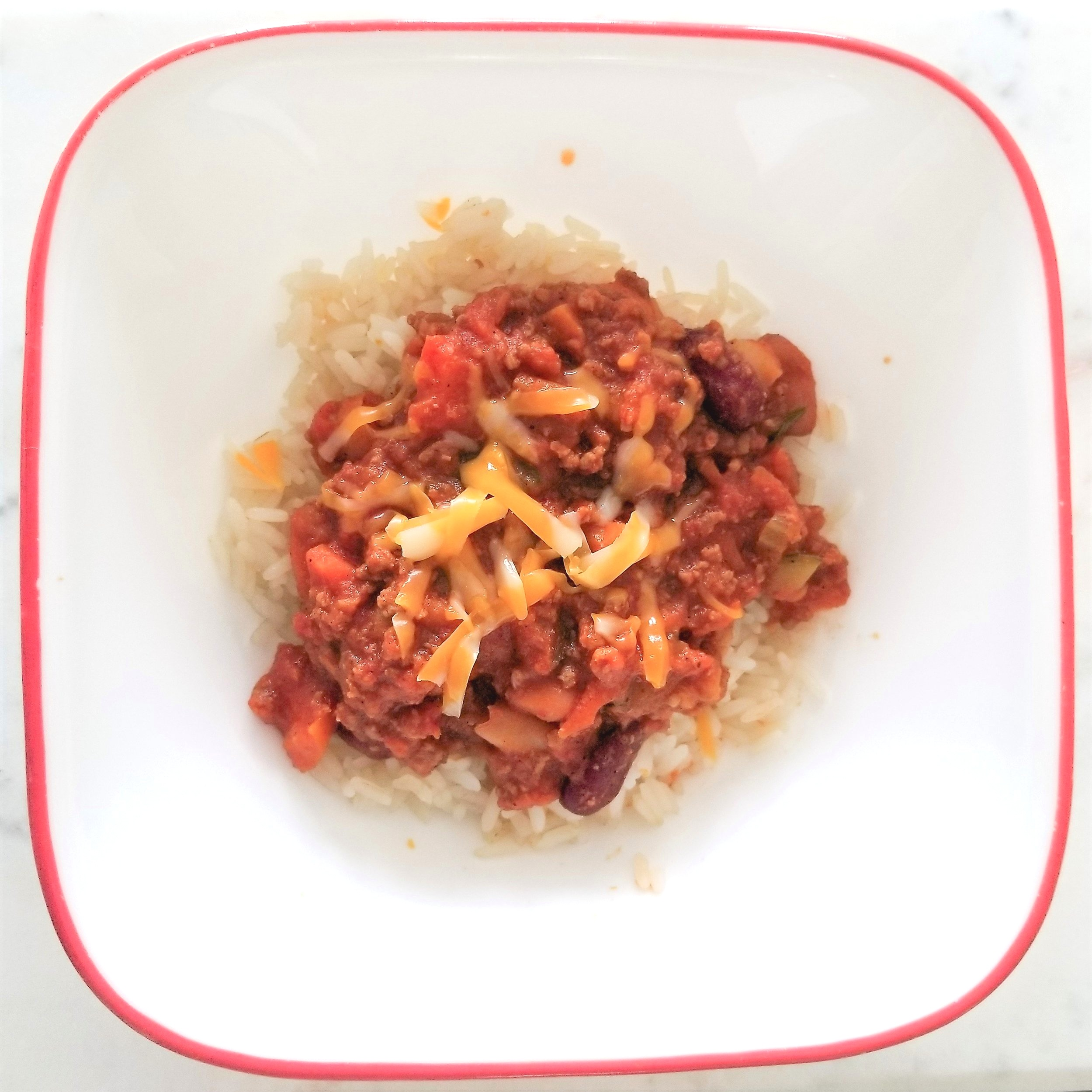Hearty chili served over rice