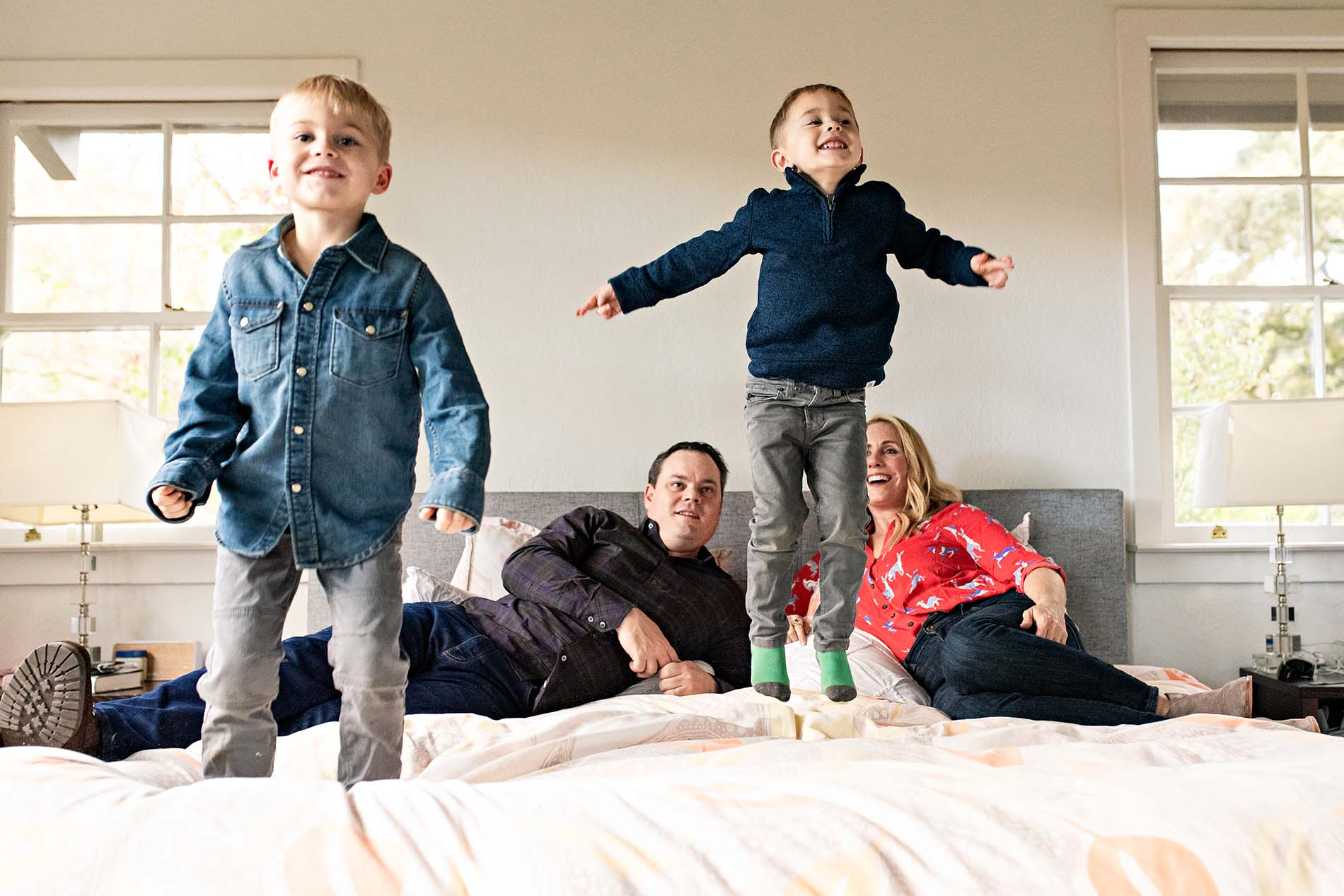 sharon kenney family photography jumping on bed