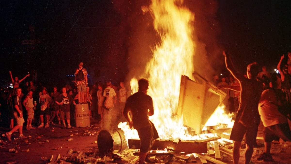People Dancing Around a Bonfire at the Red Hot Chili Peppers Festival Closing Set