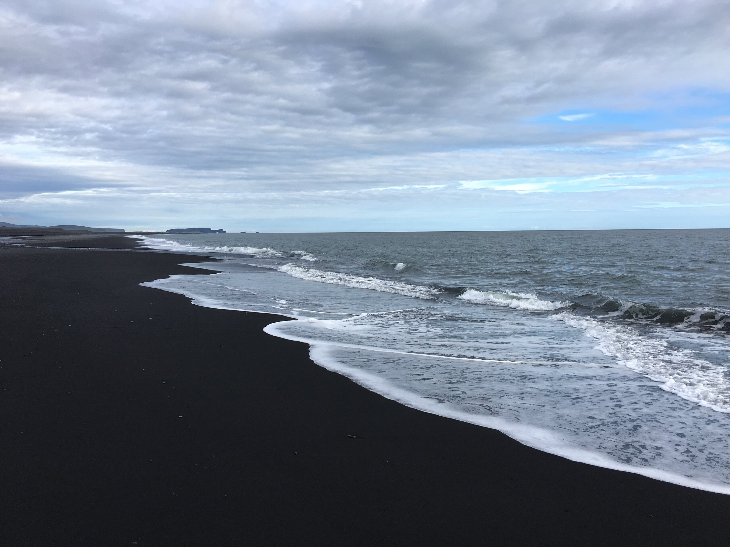 The black sand beaches.