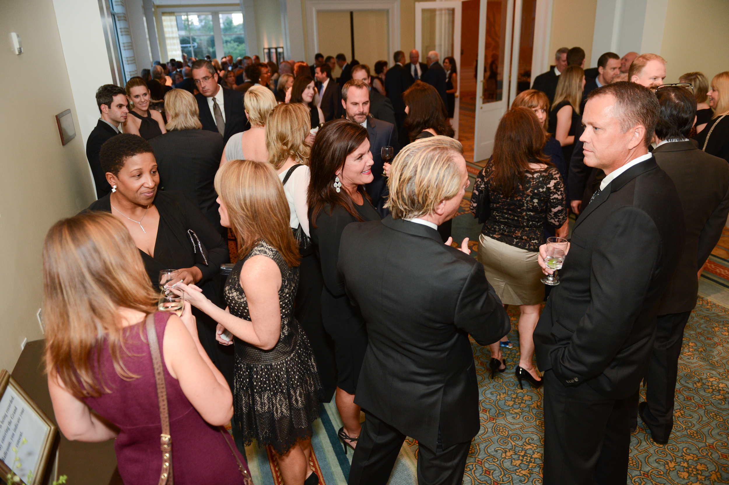 Guest mingle at a reception for the Woodrow Wilson Center.