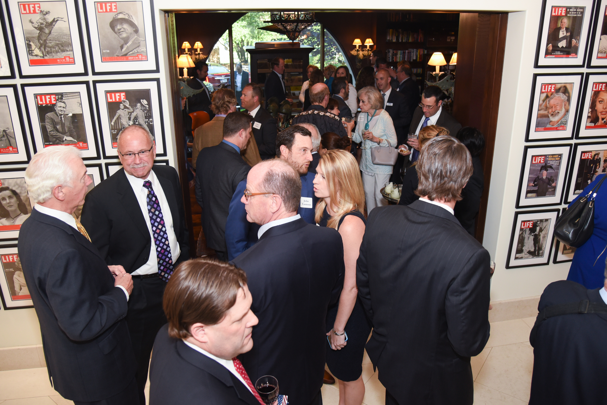 Guests mingle at the Ryan Zinke for Congress Dallas reception in May 2016.