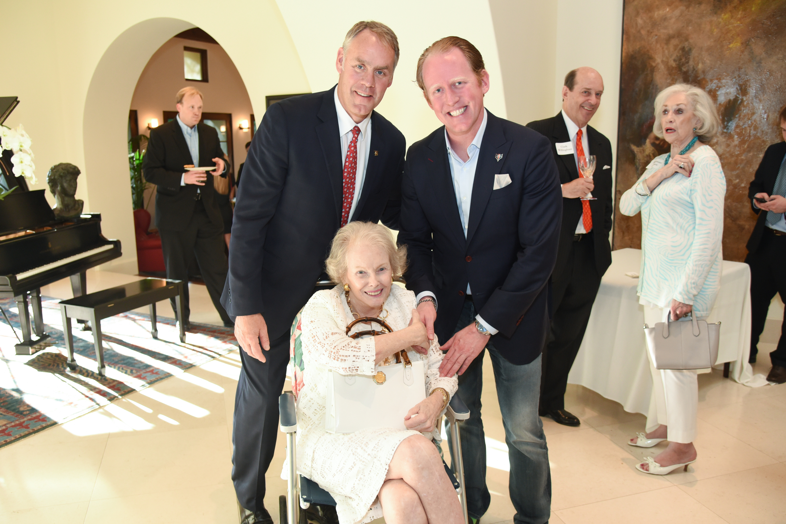 Former Secretary Ryan Zinke and Rob O'Neill with a Dallas native and Zinke supporter at a Dallas reception in 2016.