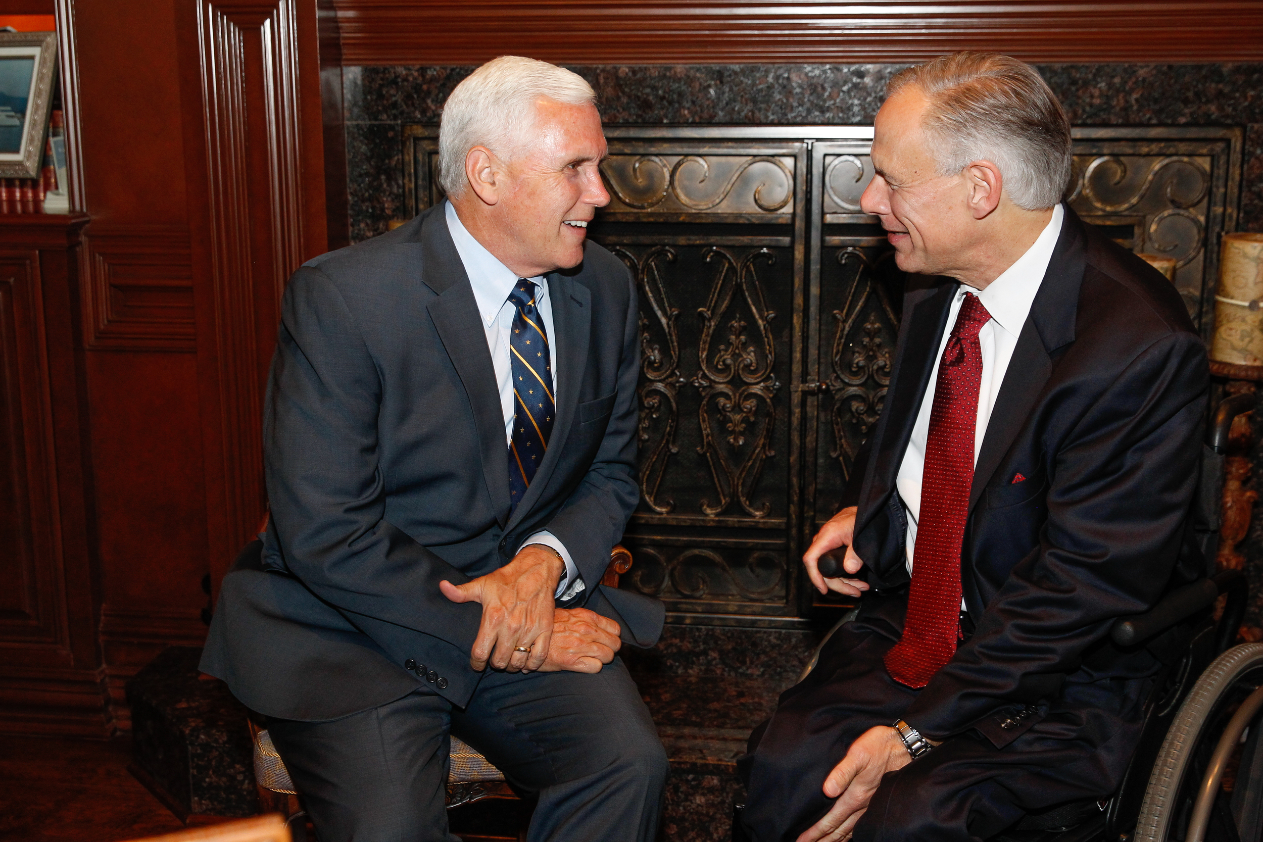 Indiana Governor Mike Pence and Texas Governor Greg Abbott talk at a May, 2016 Dallas reception for Governor Pence.