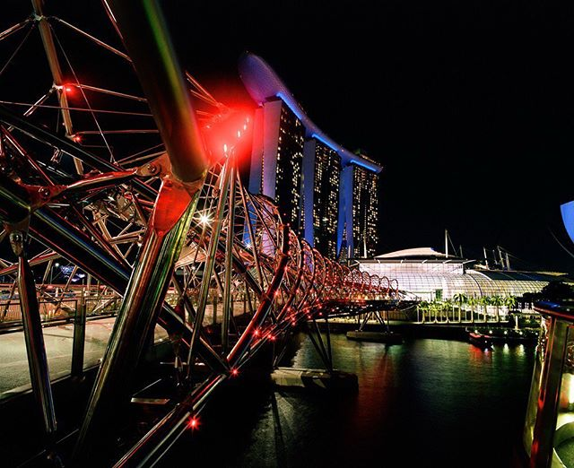 The Helix Bridge  Leave it to Singapore to create something as futurist and functional as the Helix Bridge. I think many cities could glean much from Singapore. This city is breathtakingly beautiful, clean, modern yet cultural, and even though it is as hot as can be it smells good almost everywhere we  went.  #AHPhotog Portra400 Pentax 67