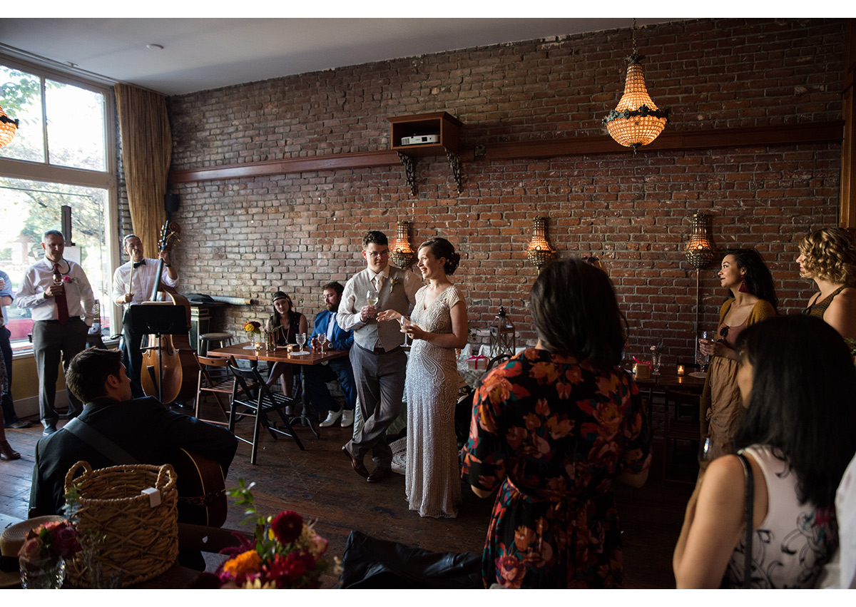 Bride and Groom giving toast at Bad Habit Room