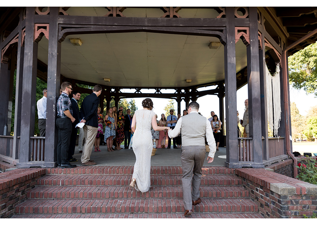 Bride and Groom walking up ceremony steps at Peninsula Park