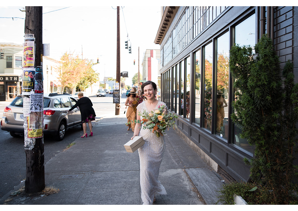 Bride walking down Portland street to wedding ceremony