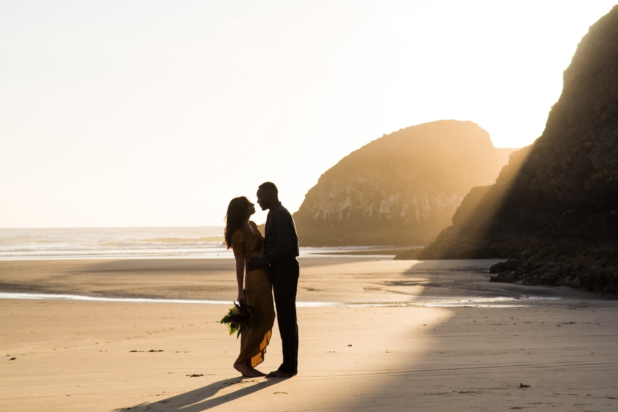 Sunset portraits of bride and groom on Cannon Beach