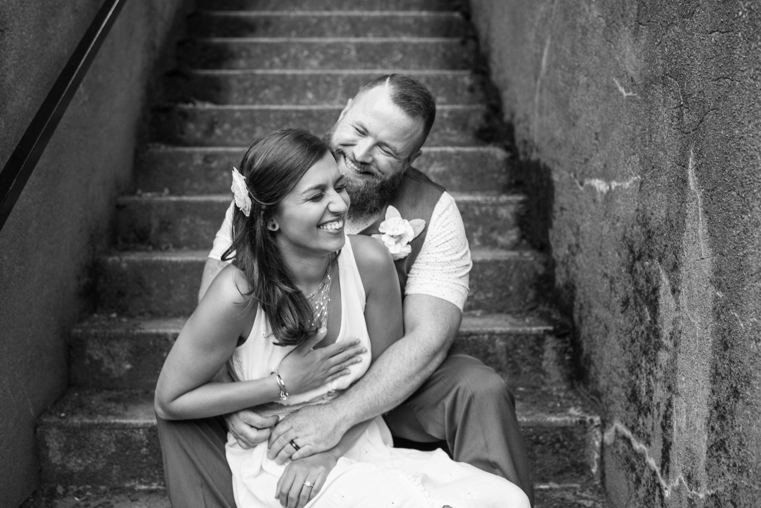 Black and white of bride and groom on steps near Pittock Mansion