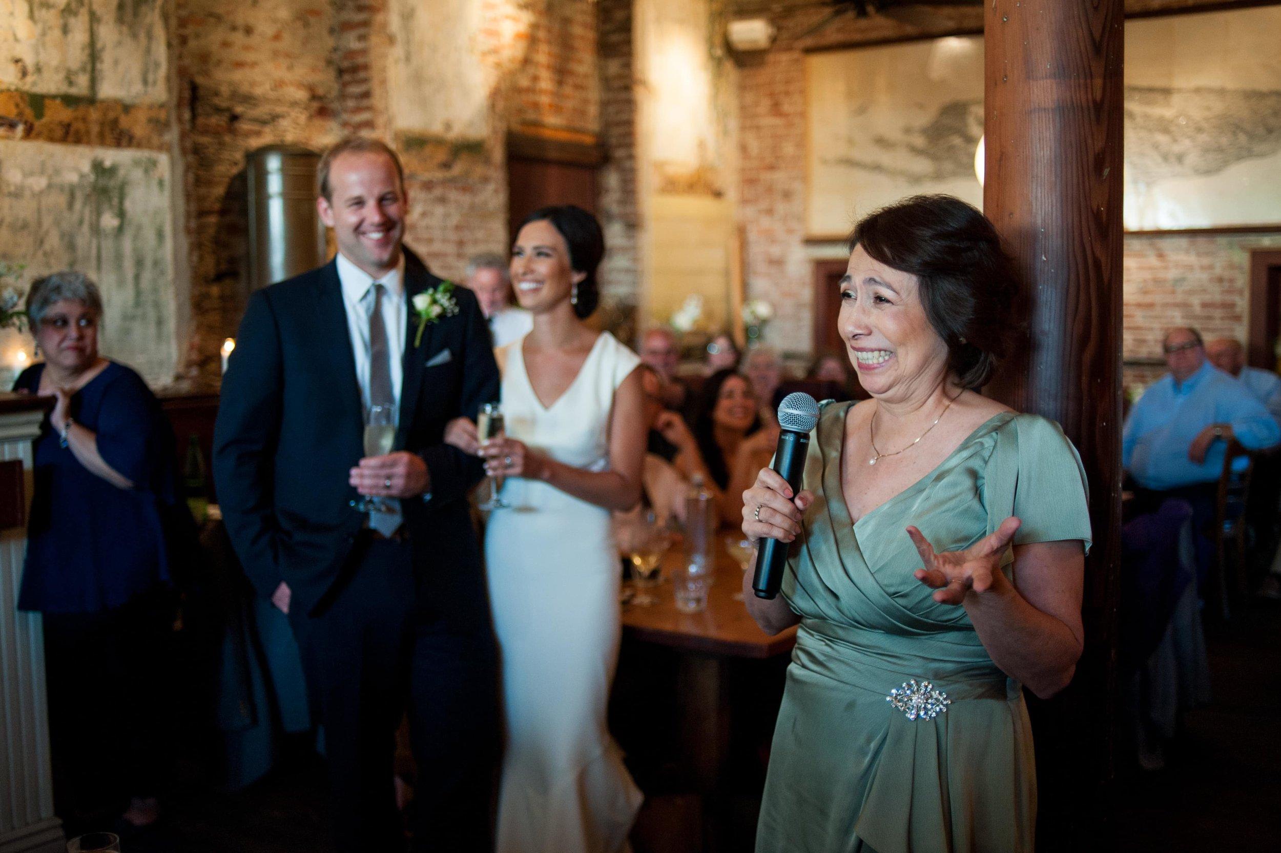 Mother of bride giving toast at Portland restaurant wedding