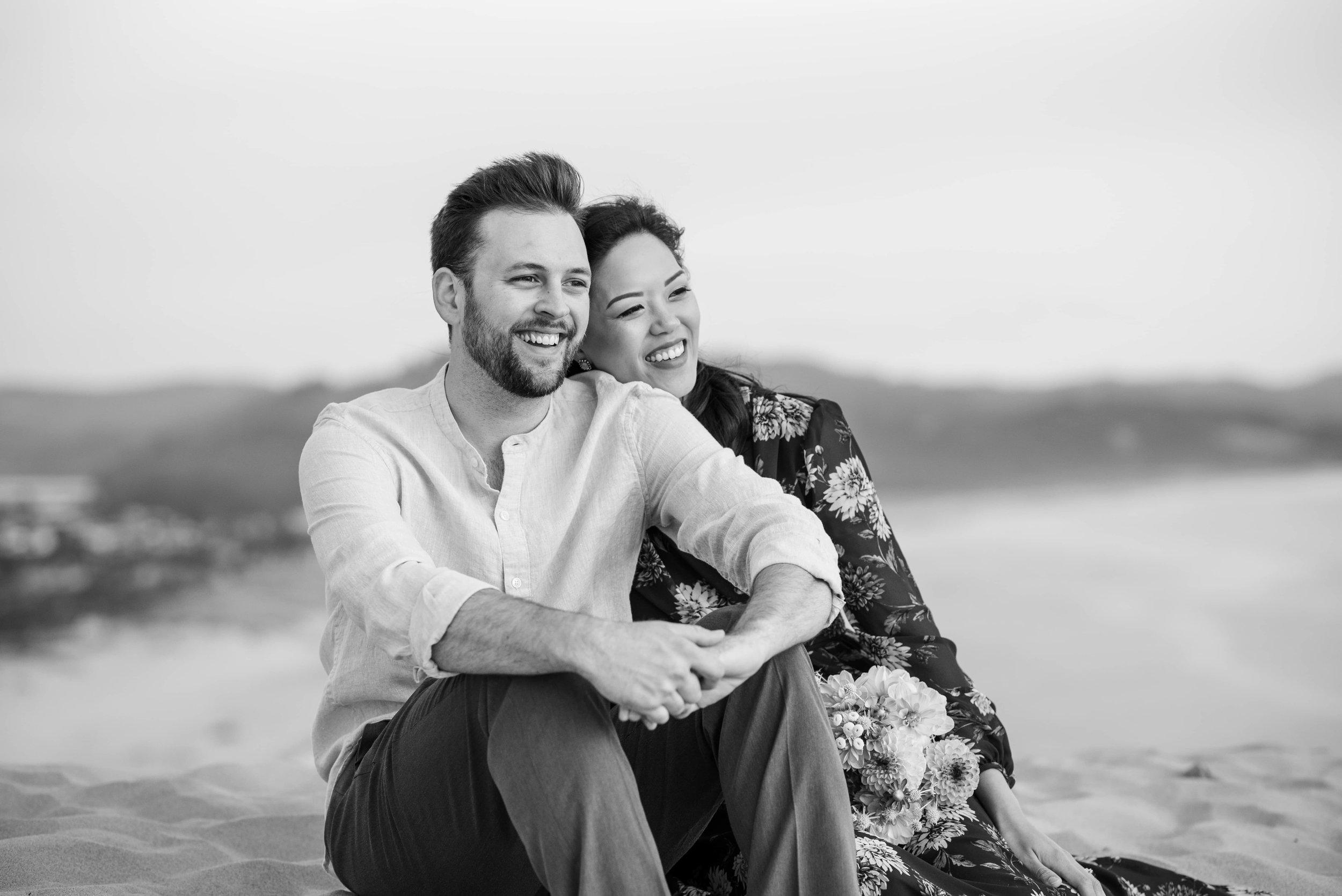 Couple sitting on dune at Cape Kiwanda Natural Area