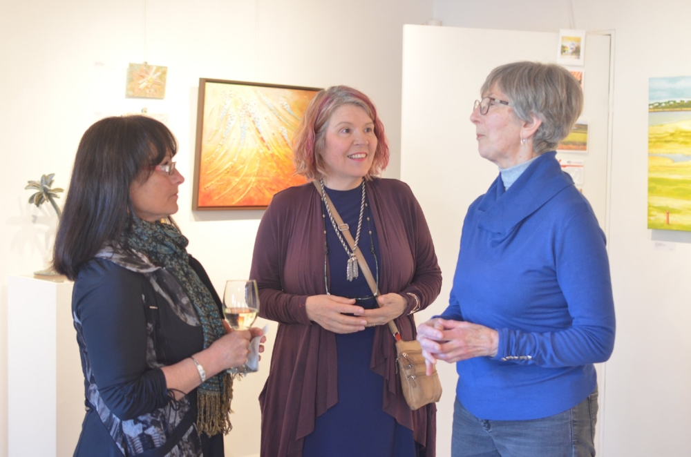My friend Marcela and I are speaking with ceramic artist, Nancy Roberts (short hair, bright blue turtleneck)