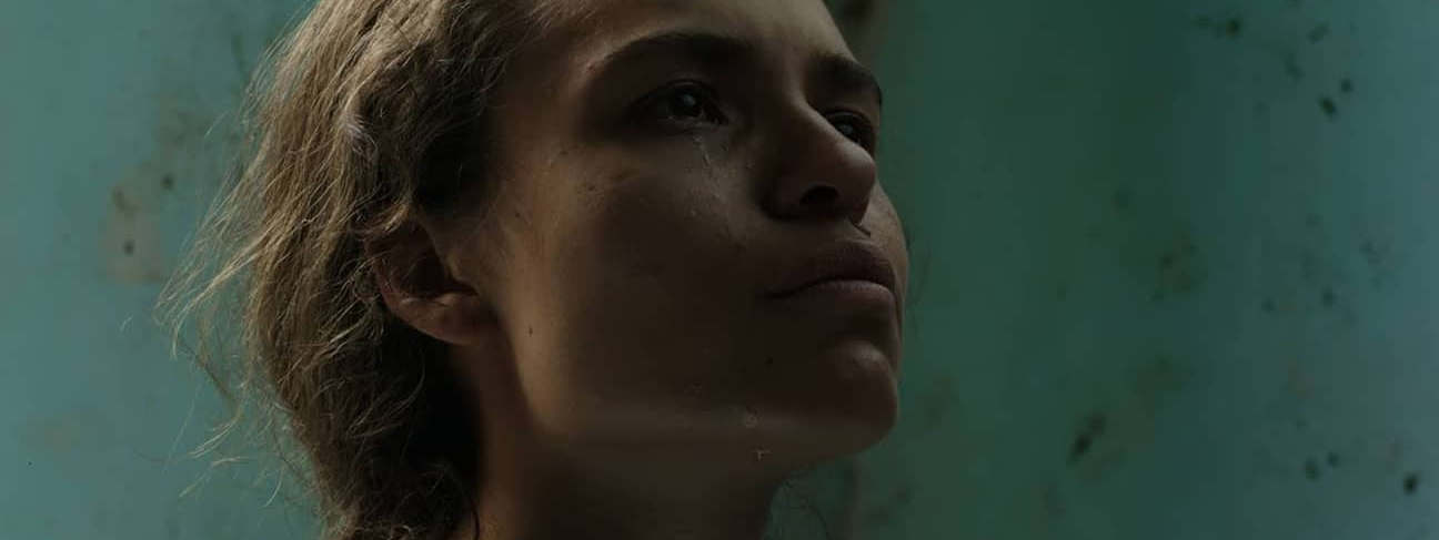 DARK ANIMAL / OSCURO ANIMAL  (Felipe Guerrero, Colombia, 2016, 107 min. In Spanish with English subtitles)  Buy Tickets   A powerful allegory about the violence of Colombia's 50-plus-year civil war, Felipe Guerrero's harrowing film literally denies its protagonists a voice. Three women—one whose village was destroyed by troops, one who stabs her paramilitary boyfriend to death and flees, and a soldier who refuses to follow her inhumane orders to bury the slaughtered villagers—find new ways to survive in Bogotá after being displaced by their respective traumas. Guerrero's trenchant symbolism explores gendered violence and the barbarism of humanity. Winner of the Spanish Cooperation Award at the San Sebastian International Film Festival.   Saturday, January 28, 3pm