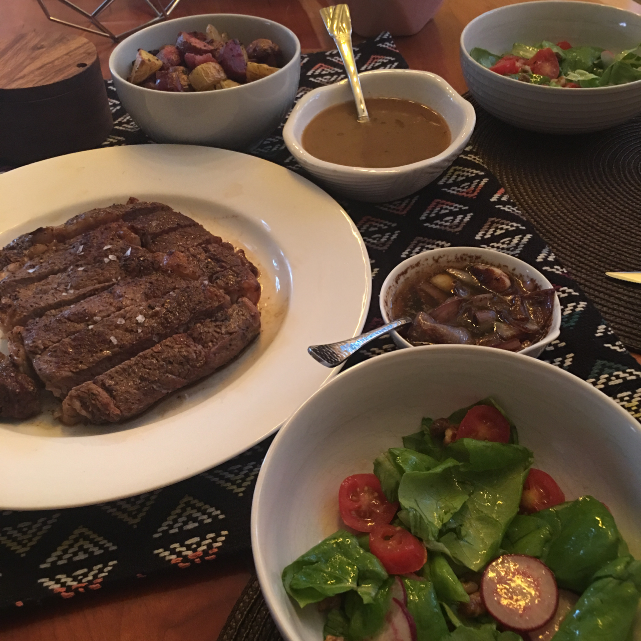 GHEE STEAK WITH ROASTED RAINBOW POTATOES, A RED ONION AND GARLIC SAUCE AND A BIBB LETTUCE SALAD WITH TOMATOES AND RADISHES IN A LEMON VINAIGRETTE