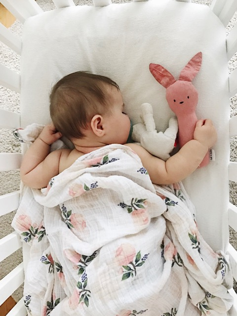 Mae at 7 months in the Bloom Alma with her  Tuk and Milo bunny.