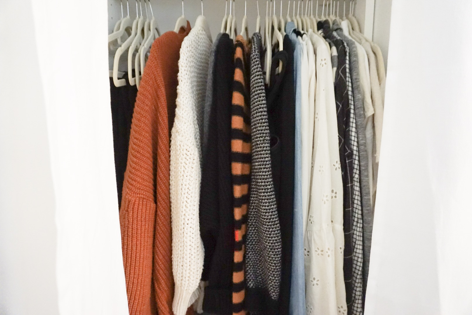 My section of hanging clothes in our closet