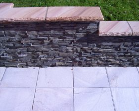 175 Sandstone Capped Stacked Stone Wall.jpg