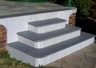 15. These solid stone bullnosed steps last forever. In this instance we used White quartzite as risers. Colour of surface can be changed to darker or lighter finish, depending on the treatment