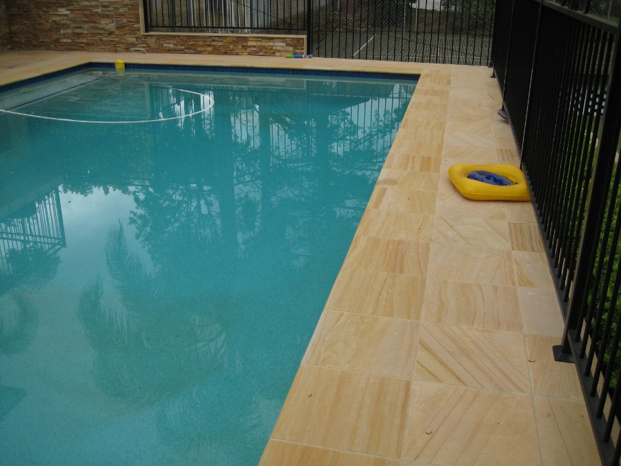 44. Woodgrain sandstone pool with stackerstone walls Photo taken 5 years after laying the tiles