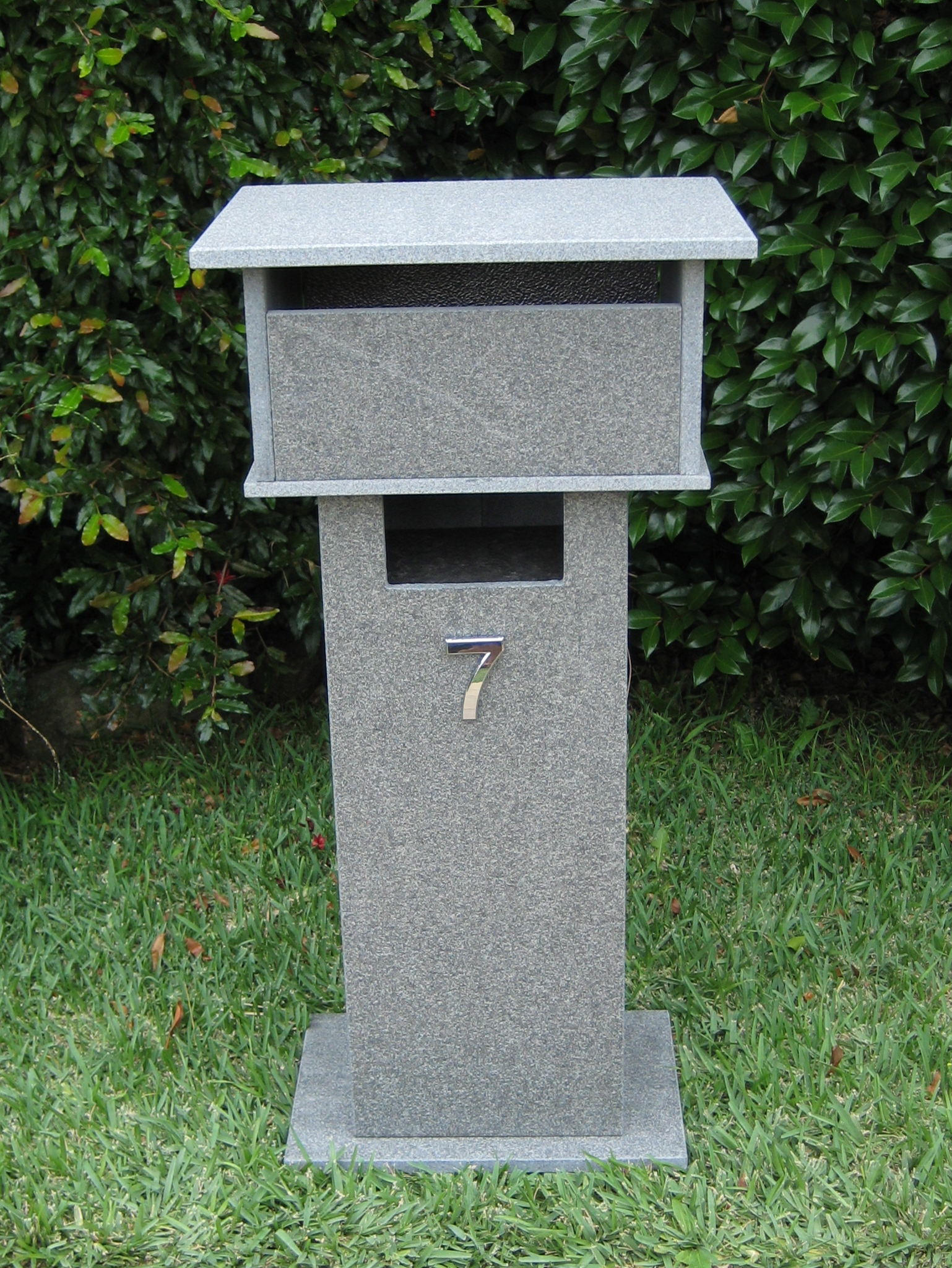 8. Blue stone letterbox with bushhammered finish. Back 2 key aluminium door. Tough material. Sizes 820x400x300 $620